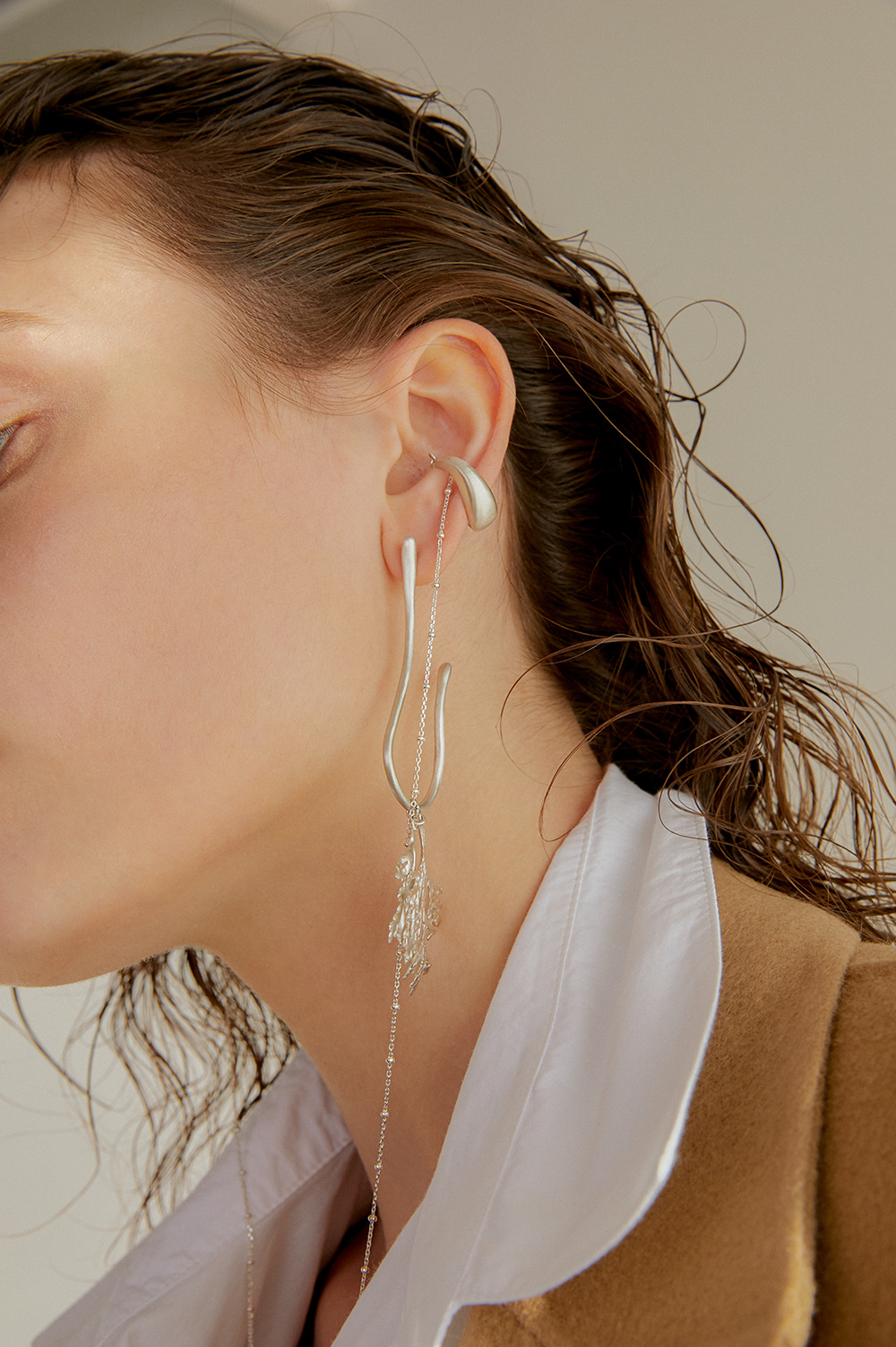 ice cubes and chain ear-cuff